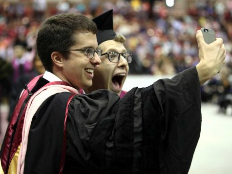 Lee Finnings, music graduate, snaps a quick selfie with Gordon Hicken, assistant professor of music, after Finnings received his certificate at Midwestern State University graduation, May 13, 2017. Photo by Timothy Jones