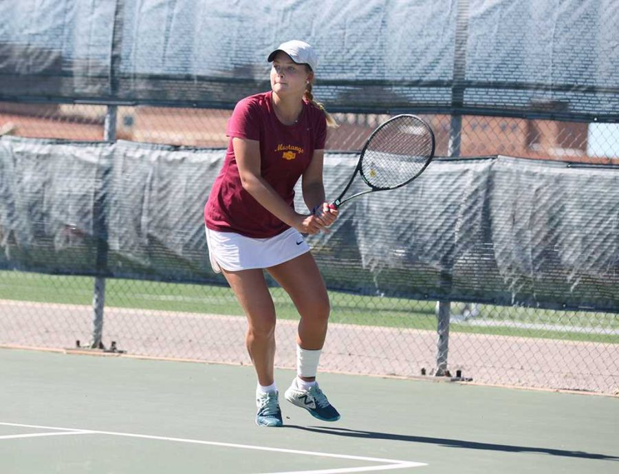 Bianca Duff, psychology freshman, prepares to swing at the ball during her tennis match against a Dallas Baptist University player on May 1. Photo by Arianna Davis