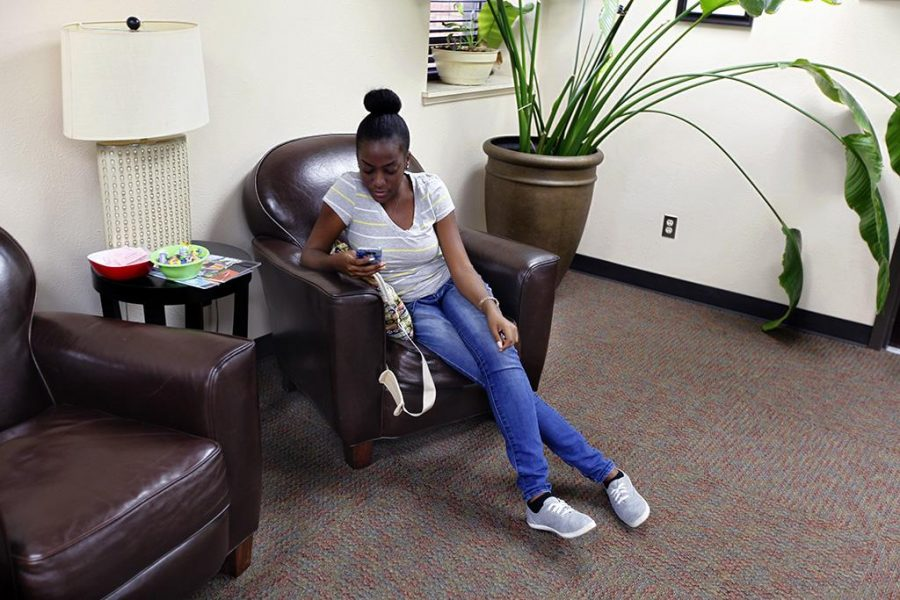 Whitney Irish, pre-dentistry freshman, waits in the Accademic Success Center on Aug. 16. Photo by Justin Marquart