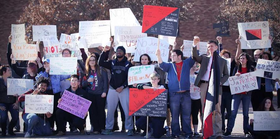 Students and faculty finish the march around campus on the Jesse W. Rodgers Promenade for the rally against the immigration executive order on Feb. 1. Photo by Bridget Reilly