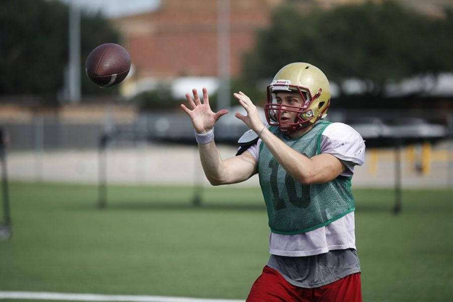 Zach Purcell, business finance freshman, catches the ball during practice on the football fields on Aug. 16. Photo by Justin Marquart