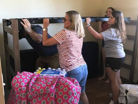 "Malorie Lang, kinesiology freshman, and Emily Lang, radiology freshman, help to set up the beds in their new room. ""The university made the transition so smooth. I'm so excited to get moved in."" Malorie said. Photo by Sarah Graves"