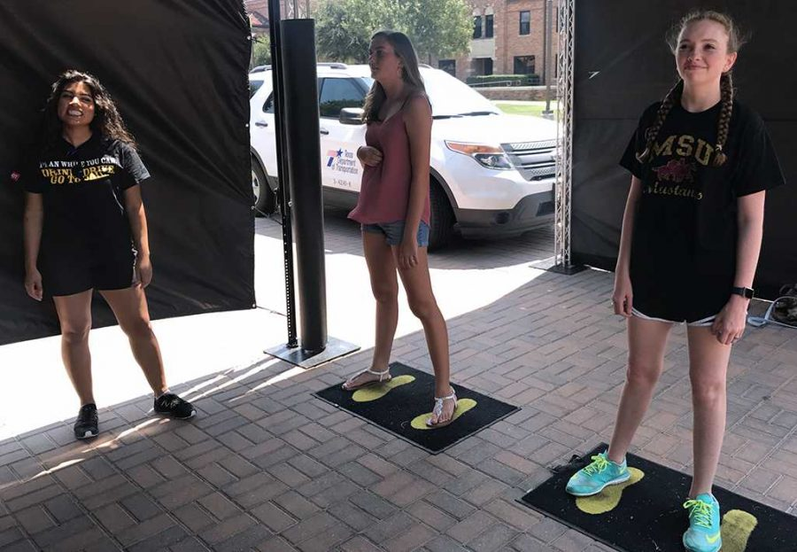 Sedona Swanner, radiology freshman, and Paige Cantrell, education freshman, play impaired dodgeball during the Texas Department of Transportation's impaired dodgeball setup on the Jesse Rodgers Promenade on Aug. 31. Photo by Sarah Graves
