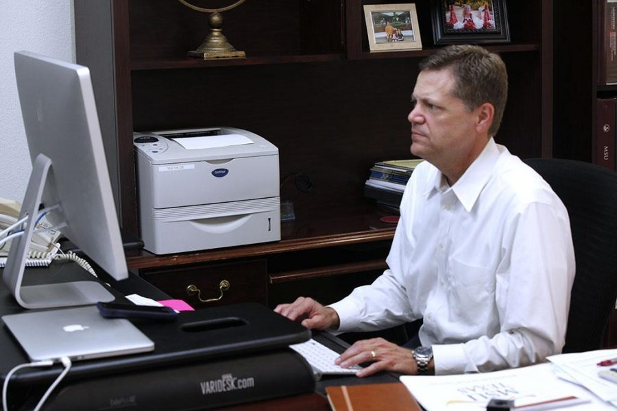 Keith Lamb, vice president of student affairs and enrollment management, sits at his desk in his new office on Aug. 15. Originally located in Hardin Administration Building, Lamb now resides in Clark Student Center, room 108. Photo by Kara McIntyre