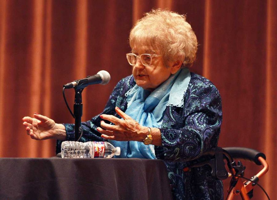 Eva Kor, holocaust survivor and forgiveness advocate, speaks to the audiance about her experience of being a holocaust survivor during the first Artist Lecture Series in Akin Auditorium on Sept. 21. Photo by Justin Marquart