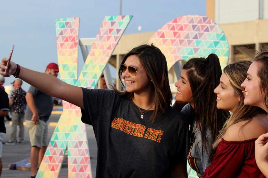 Shelbie Graham, nursing junior, Beth Townsend, early child education sophmore, Chierra Truett, nursing sophmore Paytan Deloof, education freshman show their spirit in a selfie during the tail gate at the MSU v. TEXAS A&M-KINGSVILLE at the Memorial Stadium on Sept 16. Photo by Marissa Daley