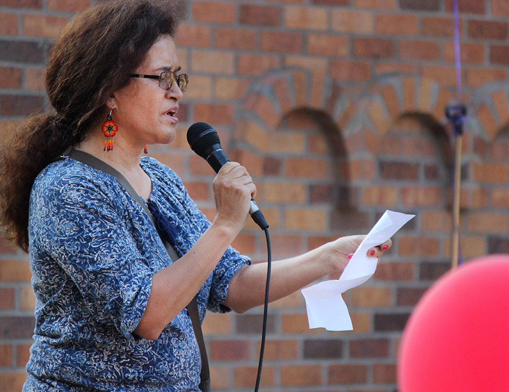 Claudia Montoya, associate professor of Spanish, gives her speech to the crowd about how they should rise above hate and that love is the real way to go about things as apart of the Resist Hate rally held in Sunwatcher Plaza Sept. 1. Photo by Rachel Johnson