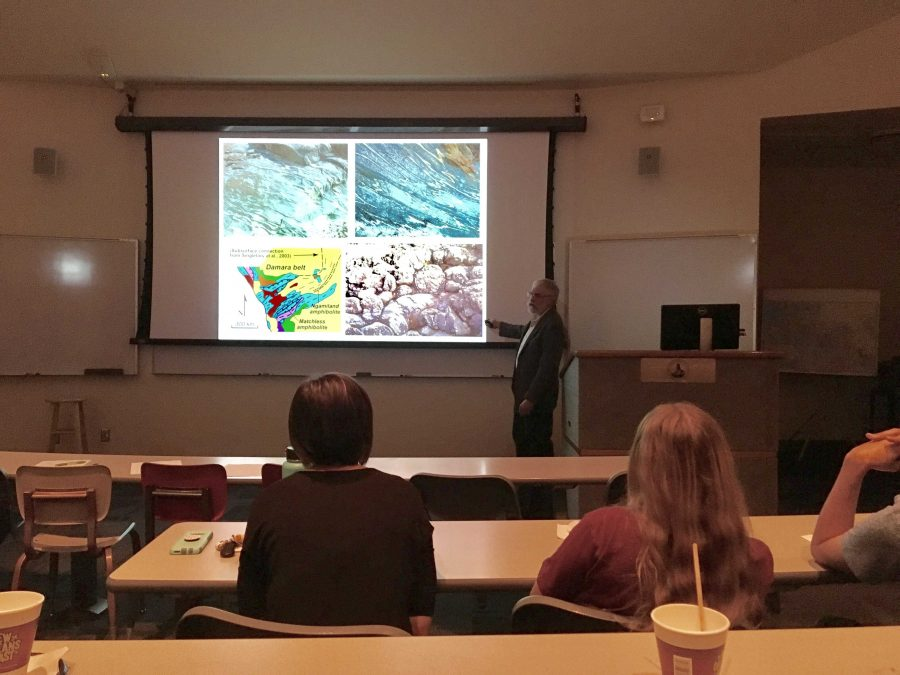 During his presentation on plate tectonics, Richard Hanson, geology, energy and environment professor from Texas Christian University, discusses his time in Zambia, Africa, working on field geology.
