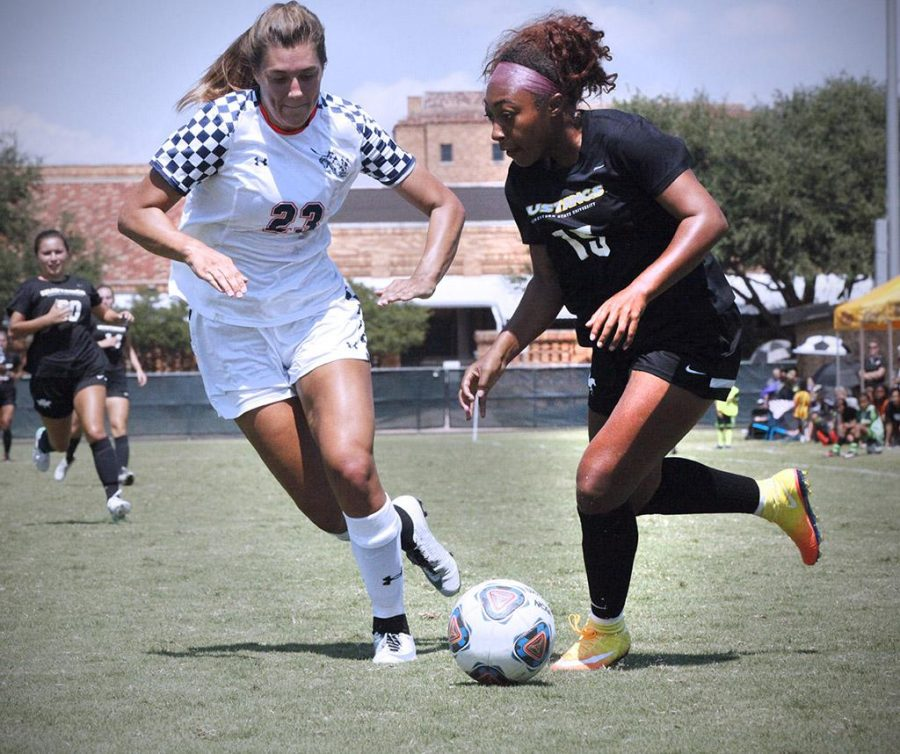 Raven Powell, midfielder and nursing sophomore, goes up against a Colorado School of Mines defender, in an attempt at scoring a goal on Sept. 3. Photo by Bridget Reilly