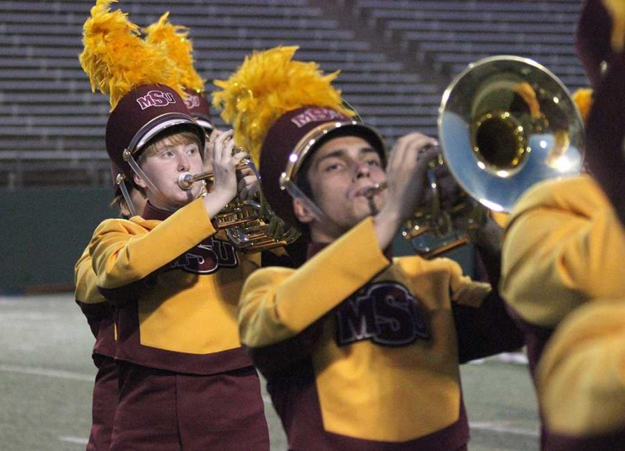 Maura Gibson, early education freshman, preforms during the halftime show during the opening game of the 2017 season at Memorial Satdium Aug. 31. Photo by Harlie David