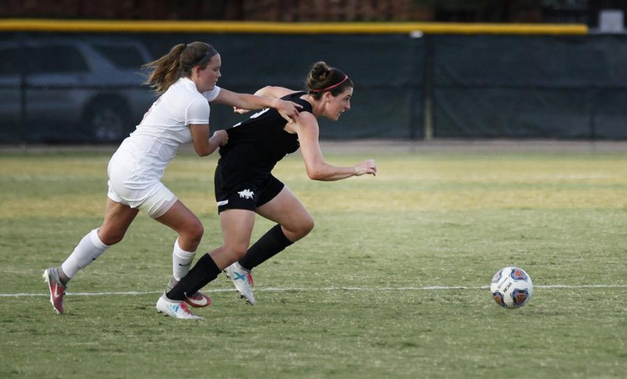 Hanna Mattinson, marketing sophomore, reaches out to obtain the ball as an opponent from Colorado State-Pueblo pulls her back during the womens soccer game on Sept. 8. Photo by Harlie David