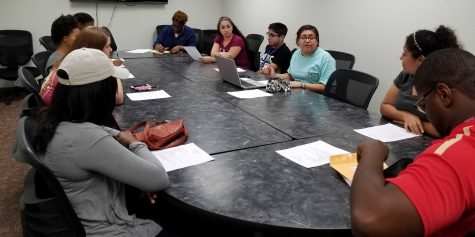 Selena Moreno (in teal), marketing and spanish junior and president of the Spanish club, addresses the club during their second meeting on Oct. 12 at the Clark Student Center.