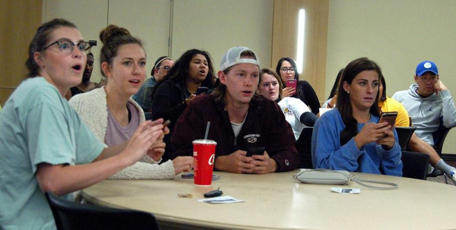 Kendall Nelms, psychology junior, Abigail Gentry, finance junior, Dalton Roehling, criminal justice sophomore, and Madison Scogin, composite science senior, participate at 90s Trivia Night in the Legacy Multipurpose Room on Oct. 17, 2017. Photo by Shea James