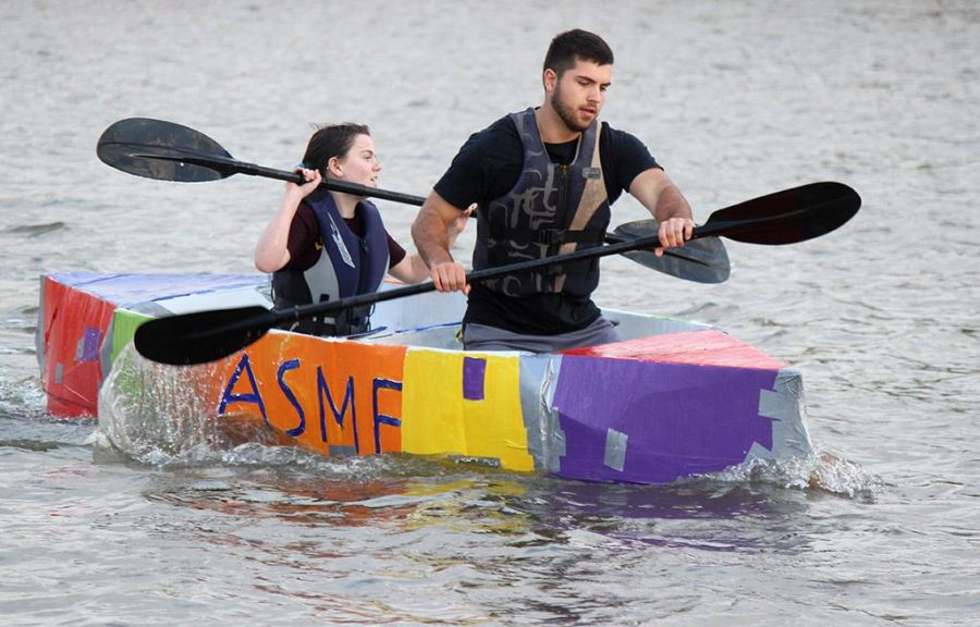 Clayton Masters, mechanical engineer junior, and Kyndal Diehm, mechincal engineer sophomore, take the lead, finishing first in the 2017 Homecoming Boat Race, Friday, Oct. 20. It was a lot of man hours to get this built. It took 84 and a half hours. It feels great, but im going to be taking a long shower after this, Diehm said. Photo by Rachel Johnson