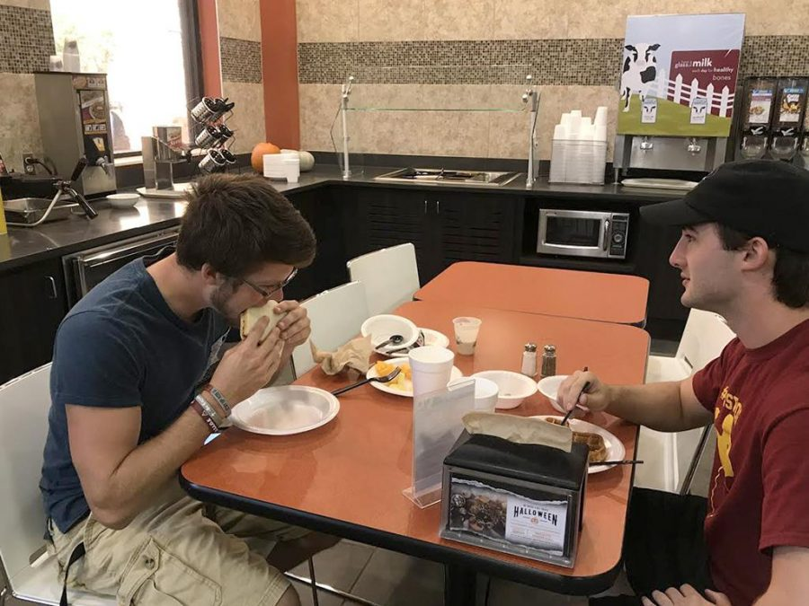 Alex Morgan-Anderson, general business sophomore, and Robbie Carper, nursing sophomore, enjoy their cold lunch options in Mesquite Dining Hall on Oct. 19. Photo by Craig Tidmore