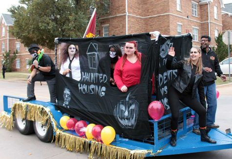 Residence Hall Association members on the Haunted Housing float during  the homecoming parade competition on Oct. 31, 2015. File photo by Kayla White