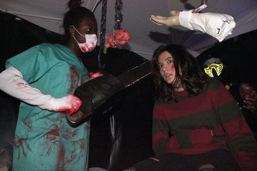 Kenadi Campbell, computer science senior, and Amber McCutcheon, psychology freshman, have a killer scene set up to scare people walking through the Haunted Maze set up by Black Student Union and University Programming Board in the quad on Monday, Oct. 30, 2017. Photo by Rachel Johnson