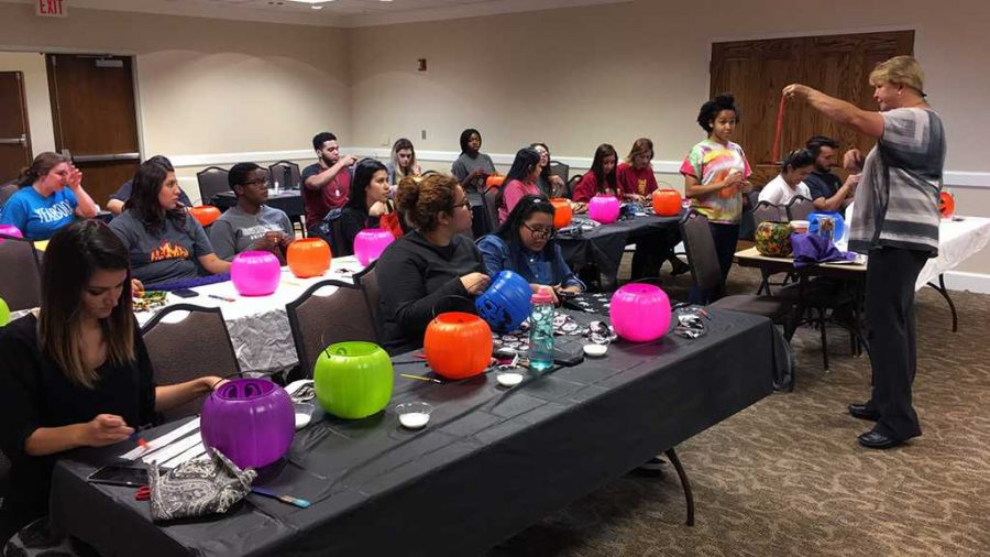 Organizer Cynthia Cummings instructs students on how to decorate their pumpkins in a Halloween class in the Kiowa Room on Oct. 12. Photo by Latoya Fondren.