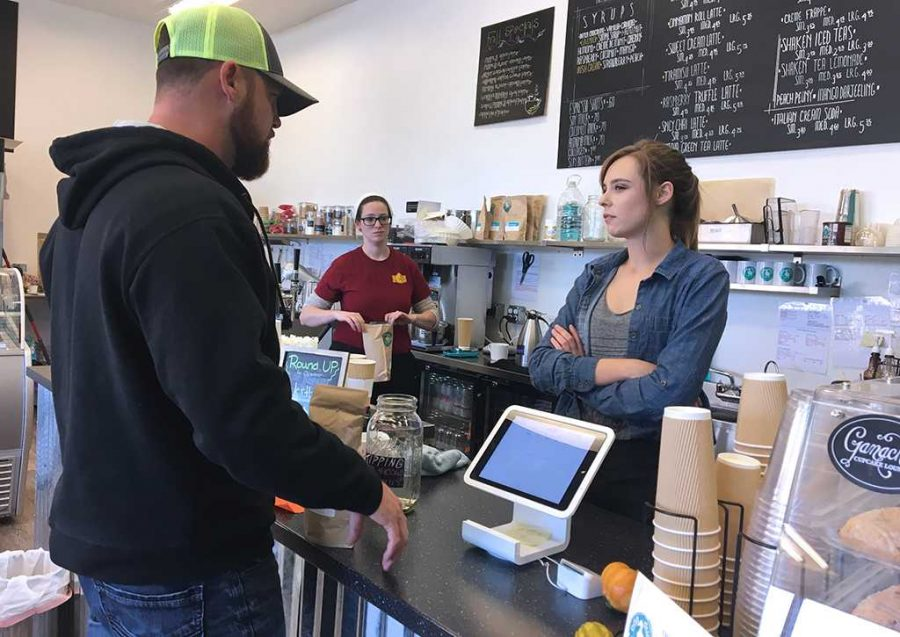 Haley Carnley, event coordinator, takes a customers order at Odd Duck Coffee. Within her position, Carnley said Odd Duck focuses on community involvement and loves the atmosphere when you walk into the shop. Photo by Cortney Wood