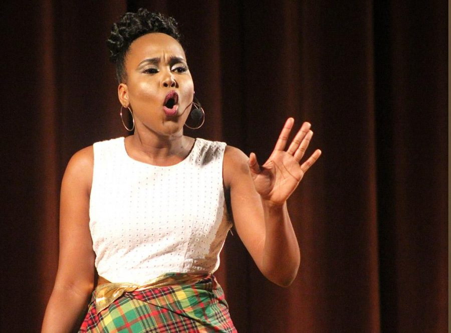 Beyandra Blanchard, radiology sophomore, performs a monologue about the different cultures between the Caribbean Islands for the 2017 Mr. and Mrs. Caribfest in Akin Auditorium on Sept 28. Photo by Marissa Daley