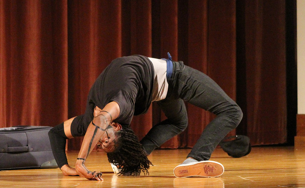 Edward Collins, psychology freshman, bends backwards in the talent portion of the the 2017 Mr. and Mrs. Caribfest in Akin Auditorium on Sept 28. Photo by Marissa Daley