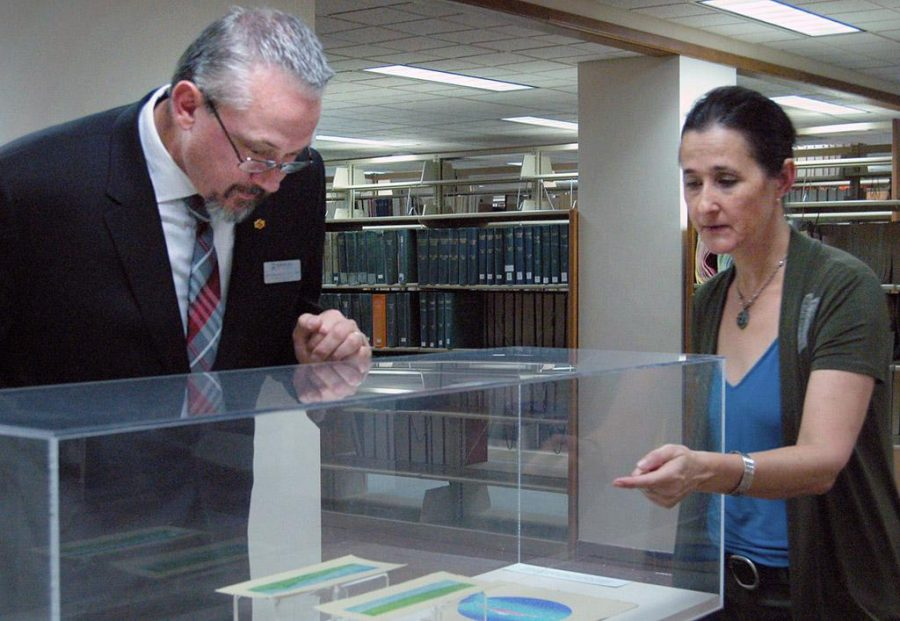 James Johnston, provost and vice president for academic affairs, and Catherine Prose, professor of art, look at model of Landscapes of Maui on Oct. 6 at Moffett Library. Photo by Shea James