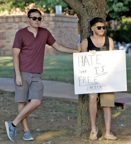 "Nick Wolf, mechanical engineering junior, and Brady Burross, mechanical engineering senior declare ""Hate speech is free speech"" during the Resist Hate Rally  held in Sunwatcher Plaza on Sept. 1. Photo by Marissa Daley"