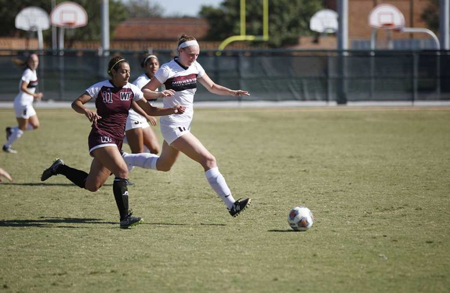 Sarah Stewart, chemistry sophomore, tries to recover the ball from an opponent during the MSU vs West Texas A&M game at Stang Park, where MSU lost 3-1, Sunday, Oct. 29, 2017. Photo by Francisco Martinez
