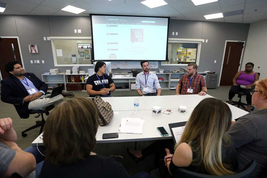 A.J. Lopez moderated the late-afternoon panel for local business leaders incluing Sam Pak, Benjamin Remmert and Logan Draper. About 20 people attended. Photo by Bradley Wilson