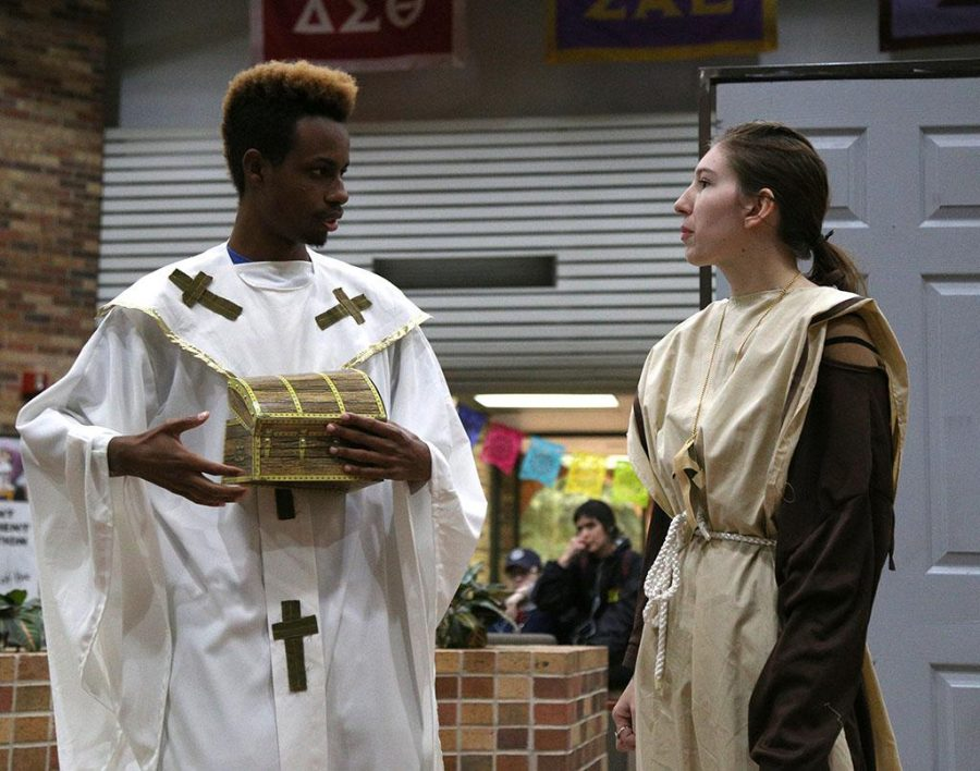 Christian Love and Autumn Dahl, both theater students, perform the Reformation in Clark Student Center Oct. 31. Photo by Elias Maki