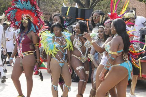Caribbean students pose for a picture during the Caribfest parade in front of Pierce Hall on Sept. 30. Photo by Sara Keeling