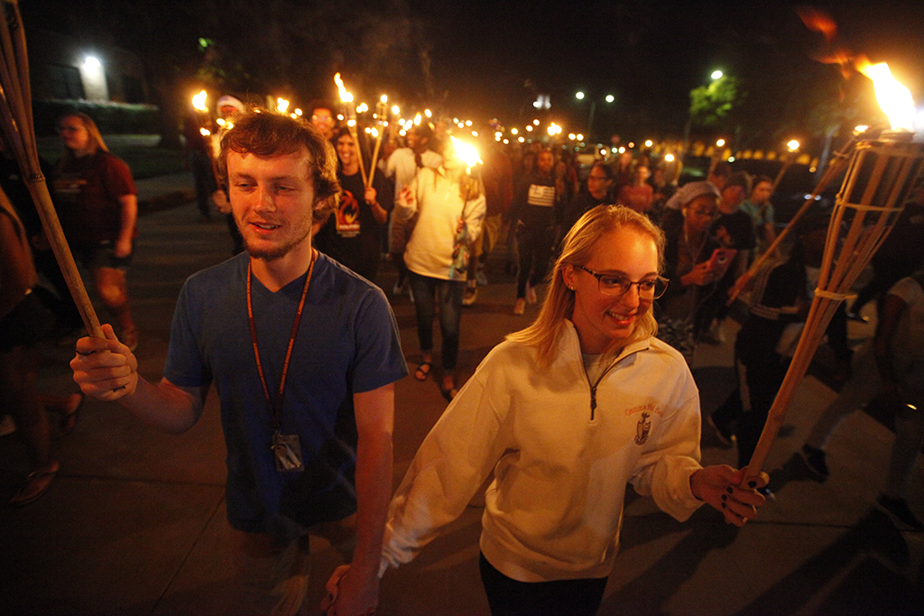 450 flames light torch parade