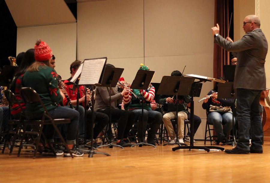 Matthew Luttrell, associate music professor, conducts the MSU Wind Ensemble during the  MSU-Burns Fantasy of Lights opening ceremony in the Akin Auditorium, Monday Nov. 20, 2017. Photo by Rachel Johnson