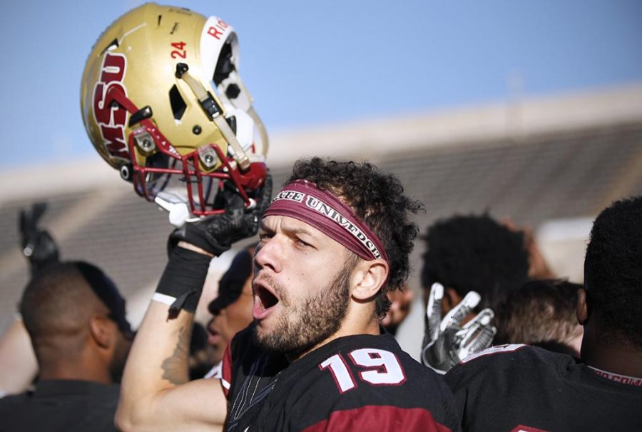 Wide receiver and psychology senior D.J. Myers cheers after beating University of Sioux Falls 24-20 in the NCAA Division II play offs. Nov 18. Photo by Bridget Reilly