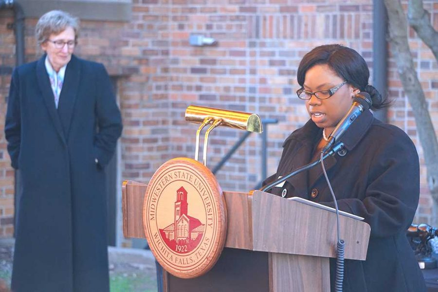 Shayla Owens, student regent, gives a speech at the Desegregation Historical Marker Ceremony on Feb. 25. Photo by Timothy Jones