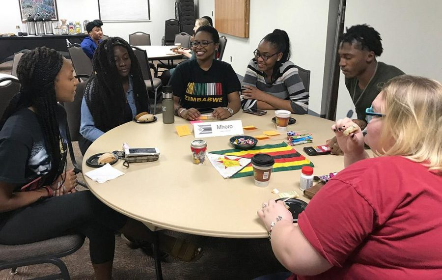 Students learn more about Zimbabwe at the Language Café in Clark Student Center on Nov. 14. Photo by Devin Field