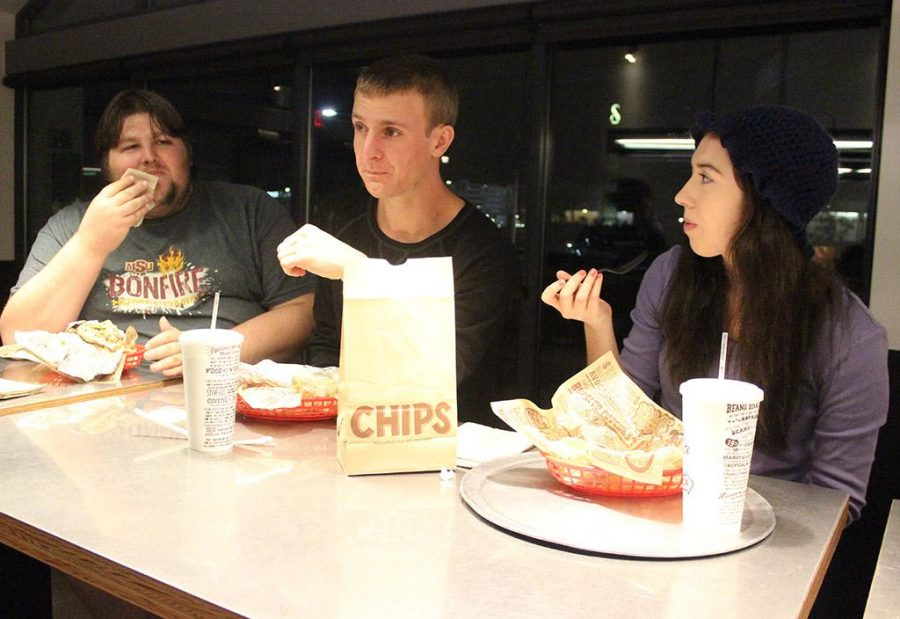Patrick German, mass communication senior, Sam Sutton, mass communication senior, and Lane Riggs, English junior, eat their dinner at Chipotle on Monday Nov. 6, 2017 in support of the Cause an Effect fundraiser for the Legacy Scholarship. Photo by Rachel Johnson