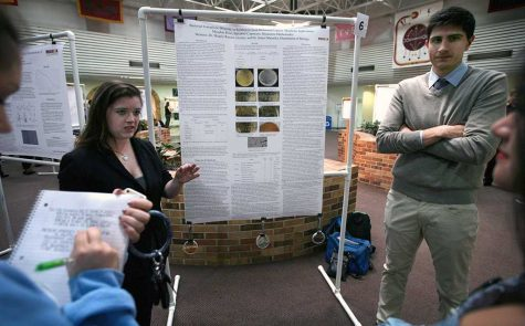 Meaghan Rose, biology senior, and Salvator Capotosto, biology senior, present their research on bacterial endophytic diversity during EUREKA on April 27, 2017. File photo by Arianna Davis