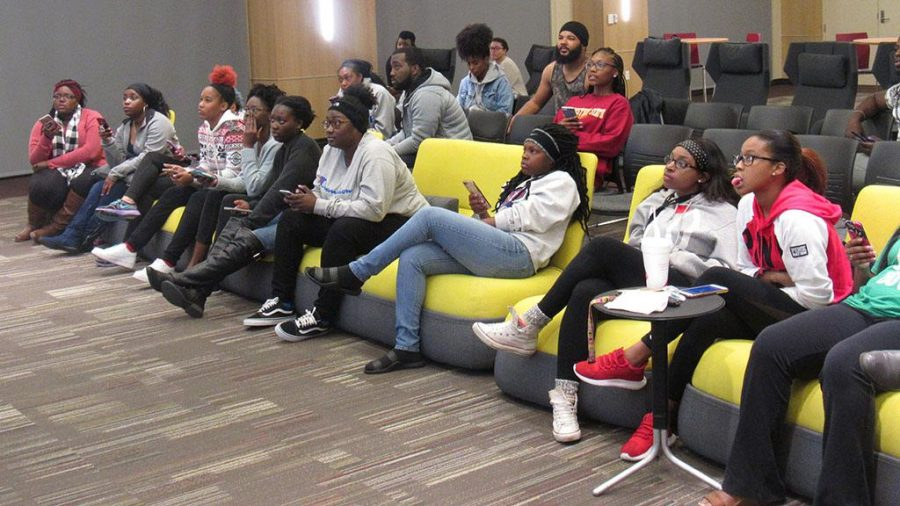 Students anxiously sit on the edge of their seats as they answer questions during trivia night in the Legacy Multipurpose Room Nov. 9. Photo by Latoya Fondren