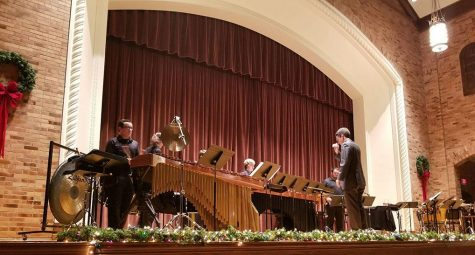Gordon Hicken, assistant professor of music, conducts music department students as they performed at the percussion ensemble at Akin Auditorium at 7:30 p.m. on Dec. 4, 2017.