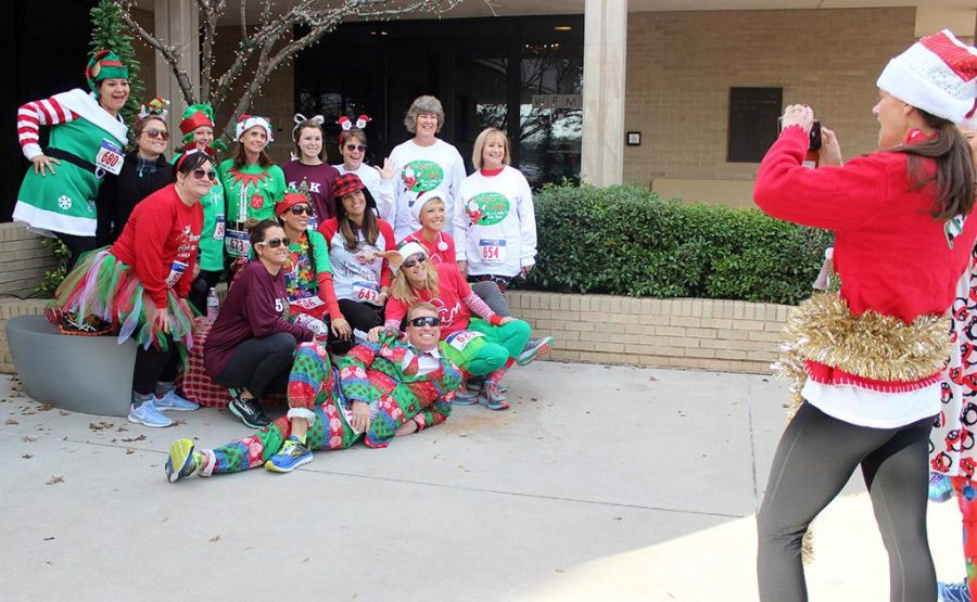 Runners for the Fantasy of Lights 5k and 1 mile take a picture outside of the Wichita Falls Museum of Art before the race, December 2, 2017. Photo by Rachel Johnson