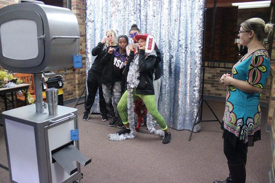 Students take goofy photos at the Photo Booth station in the atrium for Finals Frenzy, Thursday, Dec. 7, 2017. Photo by Rachel Johnson