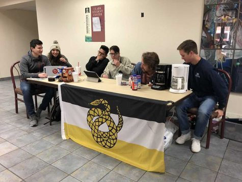 Members of Sigma Nu sell coffee and hot chocolate to raise funds Dec 6. Photo courtesy of Mia Heck.