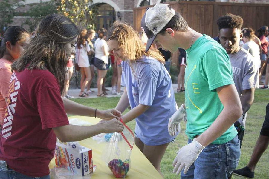 Michael Clayton, early education freshman (right), participates in events at the Cook Out on Aug. 23
