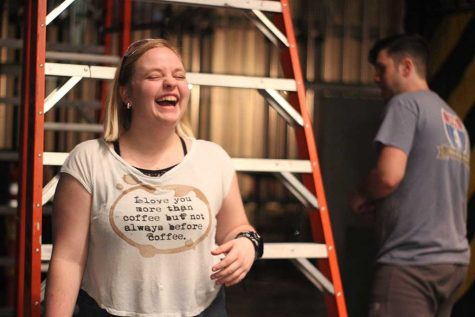 Emily Burns, theater technical theater sophomore, jokes with Joey McGinn, theater junior, during workshop hours on Tuesday, Jan. 30, 2018 for the Urinetown set. Photo by Cortney Wood
