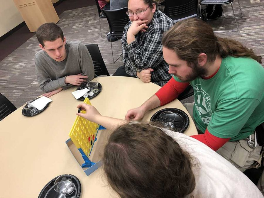 At the Late Night Scramble, Benjamin Rizzuti, psychology sophomore, Dominique Pequeno, Radiologic Technology freshman, Robert King, criminal justice and psychology junior, Samantha Rizzuti, nursing junior play connect 4 on Jan. 14
