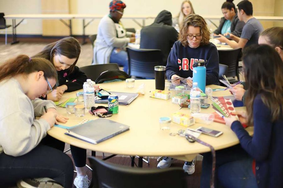 RA's work on decorations for their halls before students return from winter break at Legacy hall on  Friday, Jan 12, 2018. Photo by Francisco Martinez