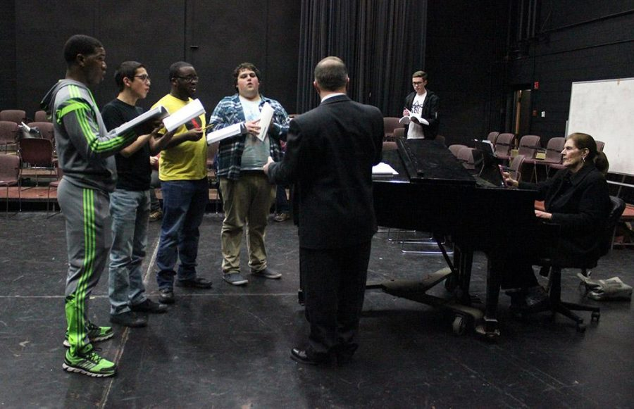 The basses and tenors practice with the direction of Dale Heidebrecht, assistant music professor,  in the Bea Wood black box theater, Tues. Jan. 16, 2018. Photo by Rachel Johnson