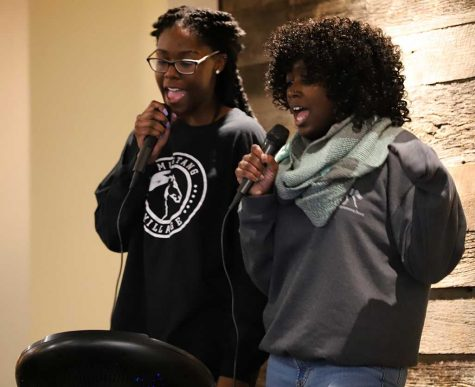 Anissia Jones, exercise physiology junior, and Taylor Barnett, mass communications junior, partake in the nacho karake event by singing the first cover song of the night in Maverick's Corner, hosted by MSU's University Programming Board, on Friday, Jan. 19, 2018. Photo by Harlie David