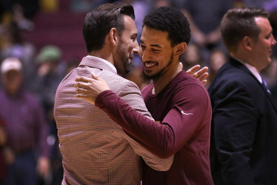 Trey Kennedy, psychology senior, hugs Assistant Men's Basketball Coach Dylan Dudley during senior night, where they honored all the upcoming graduating seniors from the athletic department inbetween the men and women's basketball games, Saturday Feb. 10, 2018. Photo by Rachel Johnson